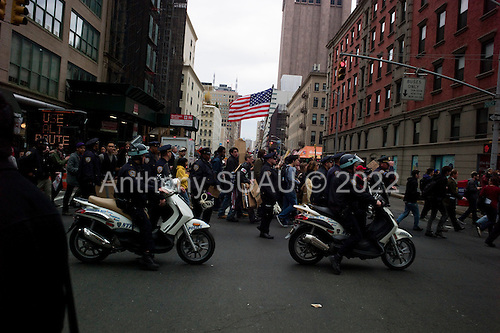 New York, New York<br /> November 15, 2011<br /> <br /> After the police clear Zuccotti Park many of the evicted &quot;Occupy Wall Street&quot; protesters, reconvened in Foley Square.<br /> <br /> From there a group marched to  Juan Pablo Duarte Square at Canal and 6th Ave and final back to Zuccotti Park to wait a court order to reenter the park.