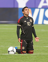 San Francisco, California - Saturday March 17, 2012: Marco Fabian prays prior to Mexico vs Senegal U23 in final Olympic qualifying tuneup. Mexico defeated Senegal 2-1