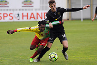 Jacob Sabua (Lae City Dwellers) and Angus Kilkolly (Team Wellington) in action during the 2018 OFC Champions League Quarterfinal between Team Wellington and Lae City Dwellers FC at David Farrington Park in Wellington, New Zealand on Saturday, 7 April 2018. Photo: Dave Lintott / lintottphoto.co.nz