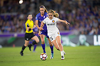 Orlando, FL - Saturday March 24, 2018: Utah Royals forward Brittany Ratcliffe (25) tries to fight off the challenge by Orlando Pride midfielder Dani Weatherholt (17) during a regular season National Women's Soccer League (NWSL) match between the Orlando Pride and the Utah Royals FC at Orlando City Stadium. The game ended in a 1-1 draw.