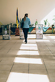 A woman walks towards a transparent box to cast her vote. Lutsk is a center of Volyn region, the region with the highest show-up in the country.