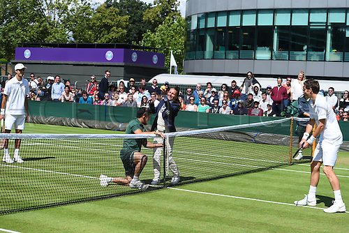 02.07.2016. All England Lawn Tennis and Croquet Club, London, England. The Wimbledon Tennis Championships Day Six.  Nicolas Mahut (fra) and Pierre Hughes herbert (fra) as the umpire has the net measured