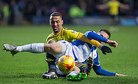 Kemar Roofe of Oxford United & Tom Lockyer of Bristol Rovers tangle during the Sky Bet League 2 match between Oxford United and Bristol Rovers at the Kassam Stadium, Oxford, England on 17 January 2016. Photo by Andy Rowland / PRiME Media Images.