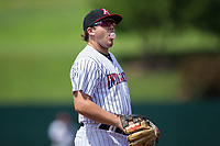 Kannapolis Intimidators third baseman Jake Burger (31) blows a bubble with his gum while on defense against the Hagerstown Suns at Kannapolis Intimidators Stadium on July 9, 2017 in Kannapolis, North Carolina.  The Intimidators defeated the Suns 3-2 in game one of a double-header.  (Brian Westerholt/Four Seam Images)