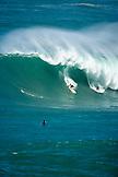 USA, Hawaii, Oahu, Kelly Slater and surfer  on a wave at Waimea bay