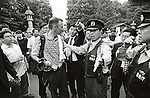 Police evict Canadian 'Artisan' Pierre Pariseau from the grounds of Yasukuni shrine after he was assualted by a member of the public during commerations for the 60th anniversy of the end of WW2. Police said 'The eviction was for his own safety' August 15, 2005. Established in 1869 by the Meiji Emperor to commerate those who died in the Boshin War. The shrine now houses the souls or 'kami' of Japan's war dead including 14 A-class war criminals who were interned among the 2.5 million war dead in 1978. Visits to the shrine by Japanese Prime Ministers create tensions with Japan's Asian neighbors. (Photo by Bruce Meyer-Kenny/AFLO)