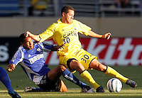 6 August 2005: Ricardo Clark of the Earthquakes tackles the ball against Eric Vasquez of the Crew during the first half of the game at Spartan Stadium in San Jose, California.  Earthquakes is leading Crew, 1-0 at halftime.     Credit: Michael Pimentel / ISI
