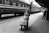 """""""Trade tourists"""" in Przemysl on the Ukrainian border bring in  bags of imported goods for sale in Poland."""