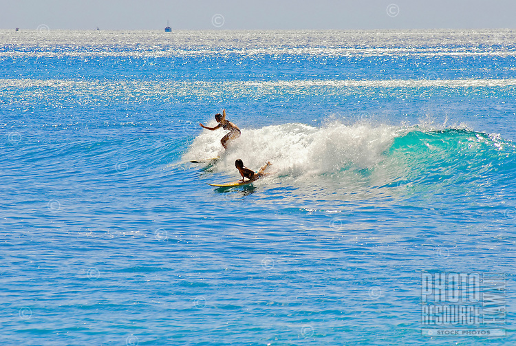Young women surfing at Makaha