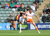 Blackpool's Jay Spearing vies for possession with Plymouth Argyle's Antoni Sarcevic<br /> <br /> Photographer Kevin Barnes/CameraSport<br /> <br /> The EFL Sky Bet League One - Plymouth Argyle v Blackpool - Saturday 15th September 2018 - Home Park - Plymouth<br /> <br /> World Copyright &copy; 2018 CameraSport. All rights reserved. 43 Linden Ave. Countesthorpe. Leicester. England. LE8 5PG - Tel: +44 (0) 116 277 4147 - admin@camerasport.com - www.camerasport.com