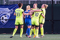 Allston, MA - Sunday, April 24, 2016: Seattle Reign FC midfielder Keelin Winters (11), defender Kendall Fletcher (13), midfielder Jessica Fishlock (10), and midfielder Kim Little (8) celebrate as Boston Breakers player McCall Zerboni (77) walks past. The Boston Breakers play Seattle Reign during a regular season NSWL match at Harvard University.