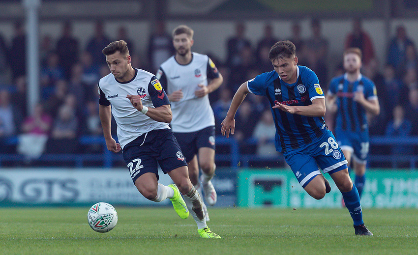 Bolton Wanderers' Dennis Politic (left) breaks away from Rochdale's  Aaron Morley <br /> <br /> Photographer Andrew Kearns/CameraSport<br /> <br /> The Carabao Cup First Round - Rochdale v Bolton Wanderers - Tuesday 13th August 2019 - Spotland Stadium - Rochdale<br />  <br /> World Copyright © 2019 CameraSport. All rights reserved. 43 Linden Ave. Countesthorpe. Leicester. England. LE8 5PG - Tel: +44 (0) 116 277 4147 - admin@camerasport.com - www.camerasport.com