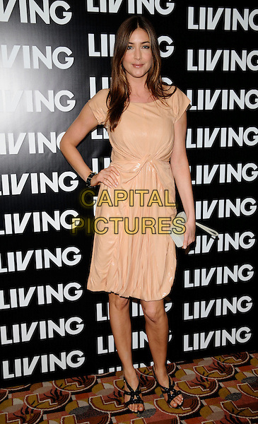 LISA SNOWDON.Attending the Living TV Summer Schedule Launch event at China Tang, Park Lane, London, England, UK,. May 14th 2008.full length beige shiny dress ruched hand on hip gathered black shoes strappy sandals clutch bag purse.CAP/CAN.©Can Nguyen/Capital Pictures