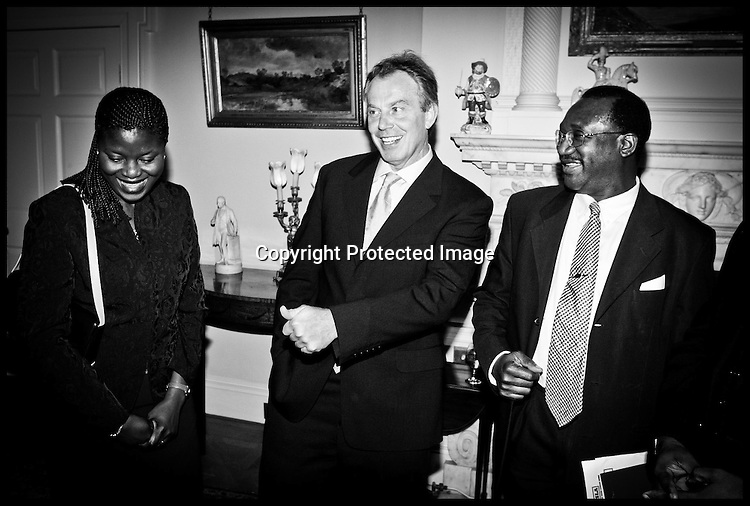 The British Prime Minister Tony Blair Meets Members of the Africian Community at Downing Street today Monday 11th October 2004.Tony Blair meets L to r Oyewo Ekelemu from Southwark Council specialist African worker and Michael Fofanah from Camberwell representing International Association of Sierra Leonians Abroad  PA Photo Andrew PArsons .ROTA