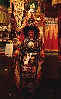 Buddhist Head Lama conducts the prayer ceremony inside Lingdum monastery, Sikkim, India