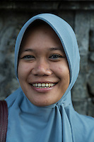 Borobudur, Java, Indonesia.  Teenage Indonesian Student from Surabaya Visiting the Temple.