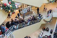 Crowds of last minute shoppers pack the Queens Center Mall in the borough of Queens in New York on the so-called Super Saturday, December 17,  2016. Because Christmas Eve and Hanukah both fall on Saturday this was the last full day of Saturday shopping before the holiday.  (© Richard B. Levine)
