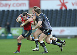 Munster centre Denis Hurley takes on Ospreys pair Ben John and Jonathan Spratt.<br /> Guiness Pro12<br /> Ospreys v Munster<br /> Liberty Stadium<br /> 07.03.15<br /> &copy;Steve Pope - SPORTINGWALES