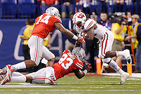 Ohio State Buckeyes safety Tyvis Powell (23) takes down Wisconsin Badgers running back Melvin Gordon (25) in the third quarter of the Big Ten Championship game between the Ohio State Buckeyes and the Wisconsin Badgers at Lucas Oil Stadium in Indianapolis, Saturday night, December 6, 2014. As of half time the Ohio State Buckeyes led the Wisconsin Badgers 38 - 0. (The Columbus Dispatch / Eamon Queeney)