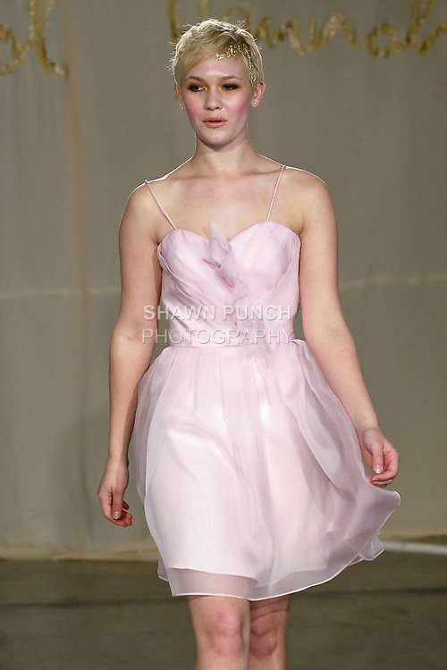Model walks runway in a Dogwood dress by Carol Hannah Whitfield, for the Carol Hannah Spring Summer 2012 Bridal collection runway show.