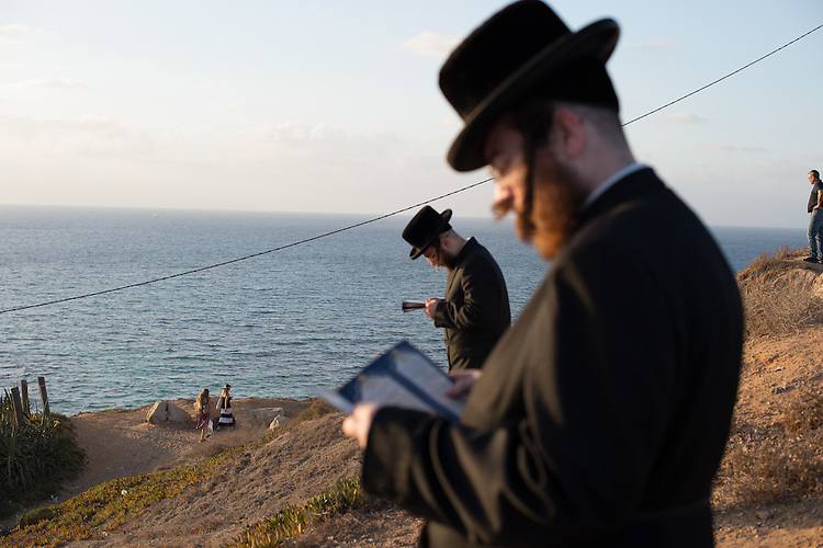 Ultra-Orthodox Jewish men pray during a 'Tashlich' ritual along the Mediterranean Sea in Herzliya, central Israel. 'Tashlich' ('to cast away') is a Jewish practice by which believers go to a flowing body of water and symbolically 'throw away' their sins, before the Day of Atonement ('Yom Kippur'), the holiest day in the Jewish calendar.