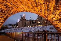 Gold medal Flower sign on the Mill City Museum framed by the Stone Arch Bridge in downtown Minneapolis, Minnesota.