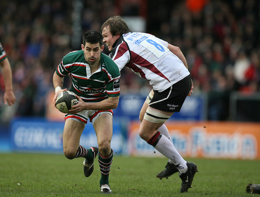 Photo: Rich Eaton...Leicester Tigers v Newcastle Falcons. Guinness Premiership. 27/01/2007. Frank Murphy, Leicester Tigers evades Falcons Russell Winter