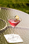 May 8, 2015. Chapel Hill, North Carolina.<br />  A Cosmo from the bar sits on a table on the lawn of the Carolina Inn.<br />  On Friday nights between April 24th and October 23rd, the historic Carolina Inn hosts Fridays on the Front Porch with local music, food trucks and drinks on the large front lawn.<br />  Outsiders tend to lump Chapel Hill with nearby Durham, but the more sensible pairing is with Carrboro, the adjacent town that was once a mere offshoot known as West End. Even today the transition from Chapel Hill, anchored by North Carolina''s flagship public university, into downtown Carrboro is virtually seamless.