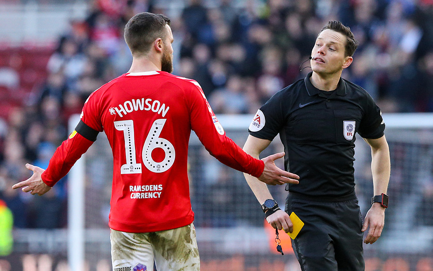 Referee Darren England shows Middlesbrough's Jonny Howson a yellow card<br /> <br /> Photographer Alex Dodd/CameraSport<br /> <br /> The EFL Sky Bet Championship - Middlesbrough v Leeds United - Saturday 9th February 2019 - Riverside Stadium - Middlesbrough<br /> <br /> World Copyright © 2019 CameraSport. All rights reserved. 43 Linden Ave. Countesthorpe. Leicester. England. LE8 5PG - Tel: +44 (0) 116 277 4147 - admin@camerasport.com - www.camerasport.com