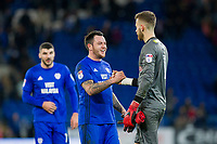 Angus Gunn of Norwich City is consoled by Lee Tomlin of Cardiff City at full time of the Sky Bet Championship match between Cardiff City and Norwich City at the Cardiff City Stadium, Cardiff, Wales on 1 December 2017. Photo by Mark  Hawkins / PRiME Media Images.