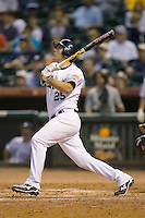 Nick DeBiasse #25 of the Rice Owls follows through on his swing versus the UCLA Bruins in the 2009 Houston College Classic at Minute Maid Park February 27, 2009 in Houston, TX.  The Owls defeated the Bruins 5-4 in 10 innings. (Photo by Brian Westerholt / Four Seam Images)