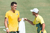 March 4, 2016: Bernard Tomic of Australia fist pumps Lleyton Hewitt after winning the first set against Jack Sock of USA during match two of the BNP Paribas Davis Cup World Group first round tie between Australia and USA at Kooyong tennis club in Melbourne, Australia. Photo Sydney Low