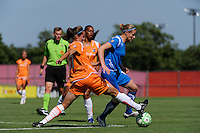 Keeley Dowling (17) of Sky Blue FC attempts a tackle on Kelly Smith (10) of the Boston Breakers . Sky Blue FC defeated the Boston Breakers 1-0 during a Women's Professional Soccer match at Yurcak Field in Piscataway, NJ, on July 4, 2009.