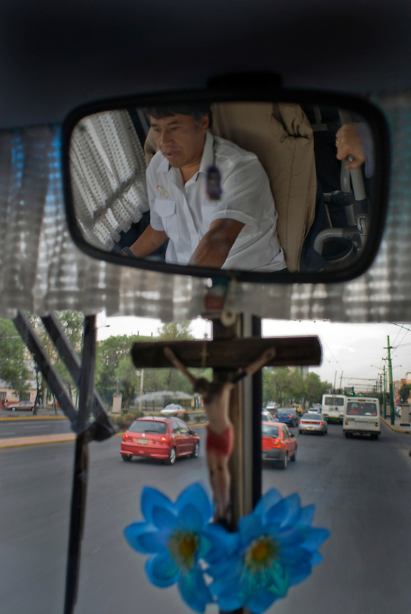 "A crucifix and flowers decorate the windscreen of Mexico City's public transportation's ""Women Only"" bus Mexico D.F., Mexico.  Wednesday, April 30, 2008"