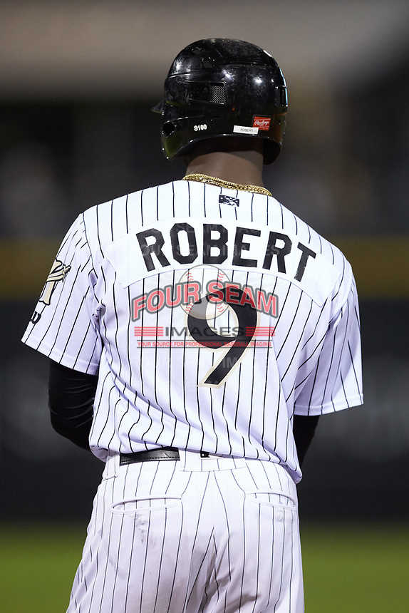 Luis Robert (9) of the Charlotte Knights stands on first base during the game against the Scranton/Wilkes-Barre RailRiders at BB&T BallPark on August 13, 2019 in Charlotte, North Carolina. The Knights defeated the RailRiders 15-1. (Brian Westerholt/Four Seam Images)
