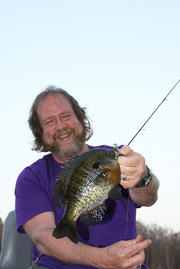 Angler with trophy bluegill caught in Richmond Mill Lake near Laurel Hill, North Carolina