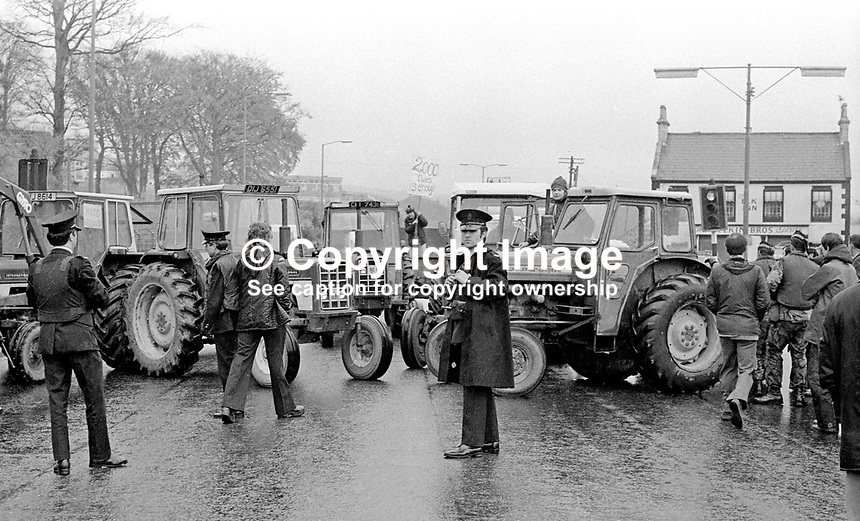 UUAC (United Unionist Action Council) Strike - farmers participating in the strike block the Newtownards Road, Dundonald, Belfast, with tractors. LH 171/77, 197705000171.<br /> <br /> Copyright Image from Victor Patterson, 54 Dorchester Park, Belfast, UK, BT9 6RJ<br /> <br /> t1: +44 28 9066 1296 (from Rep of Ireland 048 9066 1296)<br /> t2: +44 28 9002 2446 (from Rep of Ireland 048 9002 2446)<br /> m: +44 7802 353836<br /> <br /> e1: victorpatterson@me.com<br /> e2: victorpatterson@gmail.com<br /> <br /> The use of my copyright images is subject to my Terms &amp; Conditions.<br /> <br /> It is IMPORTANT that you familiarise yourself with them. They are available on my website at www.victorpatterson.com.<br /> <br /> None of my copyright images may be used on a website unless they are visibly watermarked, i.e. &copy; Victor Patterson within the body of the visible image. Metadata denoting my copyright must NOT be deleted. <br /> <br /> Web use (maximum size - 300 kb) is extra at currently recommended NUJ rates.