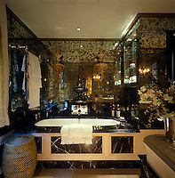 """This black marble bathroom has walls of """"verre eglomise"""" for heightened drama"""