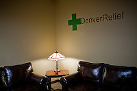 Decor at Denver Relief, a centrally located dispensary in the Denver Metro area.  The dispensary is located adjascent to the Cop Shop, a store catering to police officers.  Denver Releif's proprietors were selected from more than a dozen dispensary applicants for the retail space in the centrally located office building. ..Denver-based medical marijuana dispensaries --Colorado is one of 19 states to permit the medicinal use of marijuana.  In the city of Denver, well over 100 marijuana dispensaries have sprung up to meet the demand.  Patients are required to register with the state and have a valid doctor's note for dispensaries to sell them marijuana.