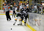 1 February 2008: University of Vermont Catamounts' forward Jack Downing, a Freshman from New Canaan, CT, battles University of New Hampshire Wildcats' forward Mike Radja, a Senior from Yorkville, IL, at Gutterson Fieldhouse in Burlington, Vermont. The seventh-ranked Wildcats defeated the Catamounts 5-1in front of a sellout crowd of 4,003...Mandatory Photo Credit: Ed Wolfstein Photo