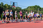 SOUTHBURY, CT. 13 July 2019-071319 - Former Post University and University of Alaska coach Al Sokaitis teaches a group of young girls a dribble drill, during a girls basketball clinic at Community House Park in Southbury on Saturday. Bill Shettle Republican-American