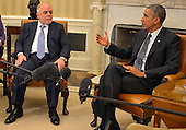 United States President Barack Obama (R) makes remarks as Prime Minister Haider al-Abadi lof Iraq istens after a bilateral meeting in the Oval Office of the White House, April 14, 2015, in Washington, DC. The leaders discussed the strategic partnership between the two countries, support in fighting ISIL as well as commercial and cultural relations.       <br /> Credit: Mike Theiler / Pool via CNP