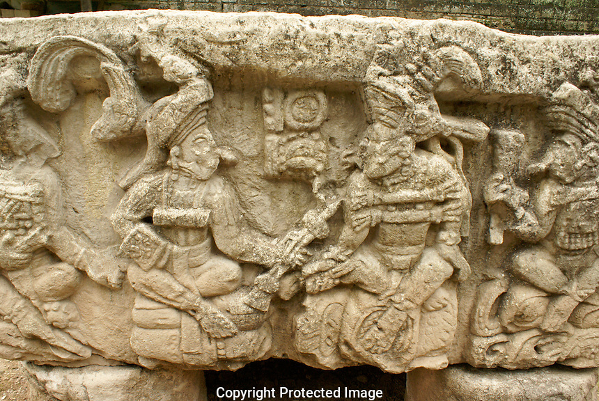 West side of Altar Q showing last ruler of Copan, Yax Pasaj, receiving the staff of rulership from the founder of the dynasty, Mayan ruins of Copan, Honduras. Copan is a UNESCO World Heritage Site.