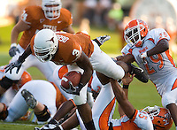 30 September 2006: Texas back Chris Ogbonnaya (#3) tries to break free from a tangle of defenders during the Longhorns 56-3 victory over the Sam Houston State Bearkats at Darrell K Royal Memorial Stadium in Austin, TX.