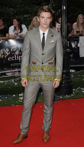 "XAVIER SAMUEL.UK Gala Premiere of ""The Twilight Saga: Eclipse"" at the Odeon Leicester Square, London, England, UK, July 1st 2010. .full length brown grey gray suit black tie shoes .CAP/CAN.©Can Nguyen/Capital Pictures."
