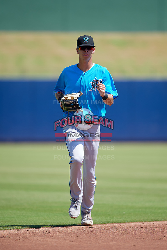 Miami Marlins center fielder Connor Scott (24) jogs to the dugout during an Instructional League game against the Washington Nationals on September 26, 2019 at FITTEAM Ballpark of The Palm Beaches in Palm Beach, Florida.  (Mike Janes/Four Seam Images)