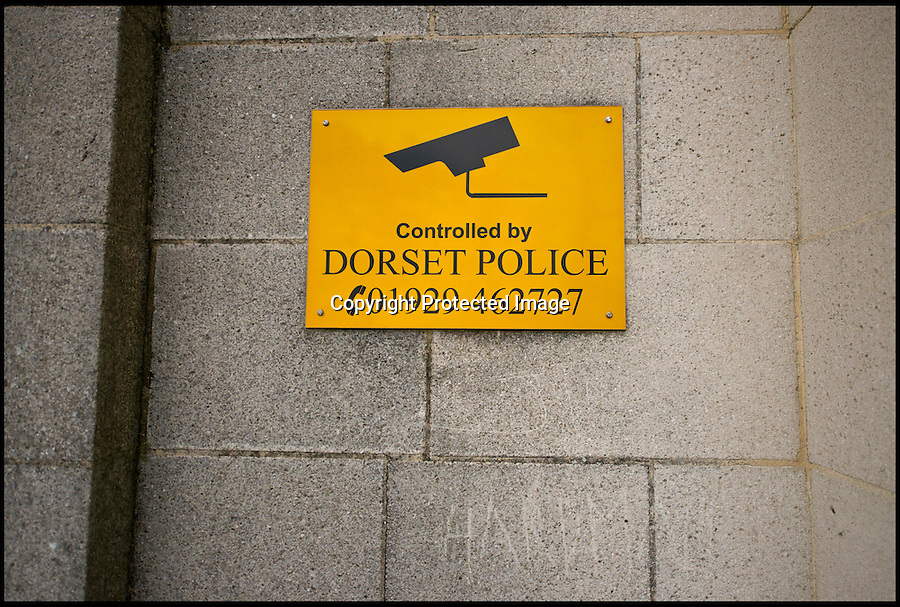 BNPS.co.uk (01202 558833)<br /> Pic: RachelAdams/BNPS<br /> <br /> Security notice on the outside wall. <br /> <br /> Potential buyers of this property that is for sale will hope to get it for a real steal.<br /> <br /> The three-storey building is actually a derelict police station that used to house scores of police officers and dozens of prisoners.<br /> <br /> The building used to serve as the main police station for Poole, Dorset, until 2009 when the force moved to a state-of-the-art HQ nearby.<br /> <br /> The 1930s building, that sits a 0.89 of an acre site, has lain mostly empty since then, at a cost of hundreds of thousands of pounds a year to the taxpayer.<br /> <br /> It is now gone on the market with interested parties invited to make sealed bids.