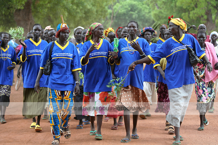 """Supported by the international NGO, Population Services International (PSI), a women's group in Rumbek, South Sudan parades on Africa Malaria Day 2006 to raise awareness about malaria prevention.  The women sport shirts stating, """"Malaria is transmitted only through the bite of an infected mosquito."""""""