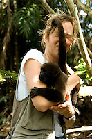 A photographer and a Woolly Monkey bonding; Napo, Ecuador