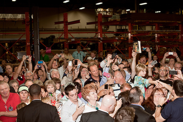 """August 22, 2012. Raleigh, North Carolina.. An audience member tried to hand Rep. Ryan a copy of """"Atlas Shrugged"""" by Ayn Rand.. Republican vice presidential candidate Paul Ryan held a campaign rally at SMT, Inc., a metal fabrication factory, where he railed against the Obama economic plan and spelled out how his and Gov. Romney's plans would differ if elected in November."""
